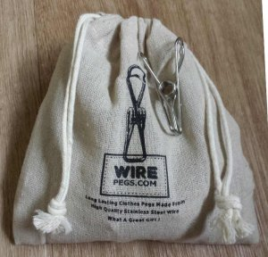 63 grade 201 Stainless Steel Wire Clothes Pegs in a hemp bag